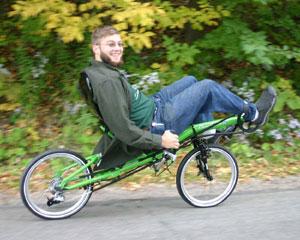 Green HP Velotechnik Grasshopper being ridden