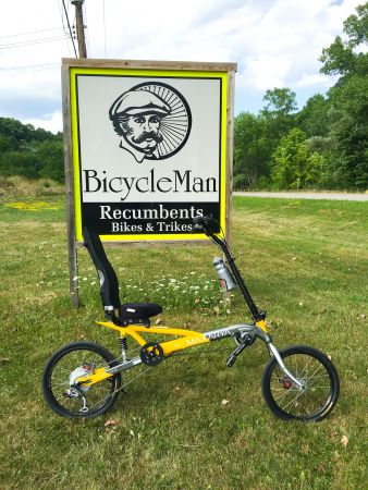 Maxarya Ray 2d in front of the Bicycle Man Sign
