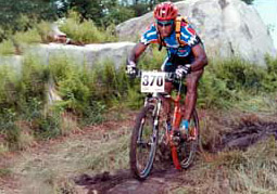 Racing a Fuji MTB on a downhill trail.